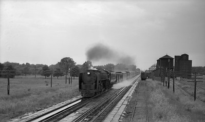 2021.003.NYC.0003--john s ingles PC neg--NYC--steam locomotive on eastbound passenger train action taking water from pans--Chesterton IN--no date