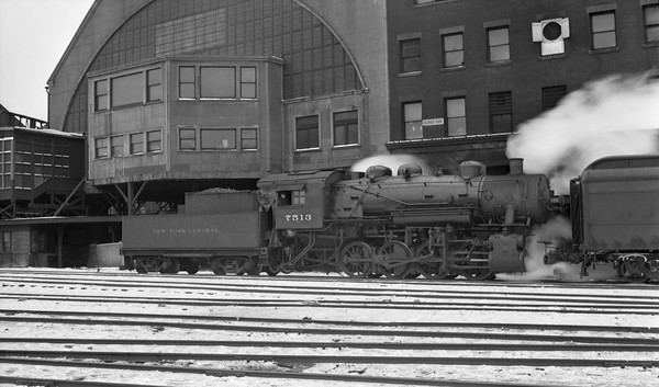 2021.003.NYC.7513--john s ingles PC neg--NYC--steam locomotive 0-8-0 7513 switching passenger cars at Central Station (12th Street) action--Chicago IL--no date