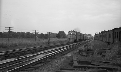 2021.003.NYC.0007--john s ingles PC neg--NYC--EMD diesel locomotive on eastbound passenger train action--Chesterton IN--no date