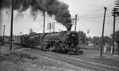 2021.003.CO.1162--john s ingles PC neg--C&O--steam locomotive 1162 on eastbound freight train action--Griffith IN--1946 0825