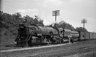 2021.003.CO.2338--john s ingles PC neg--C&O--steam locomotive 2-8-2 2338 on eastbound freight train leaving for Chicago--Griffith IN--1946 0825