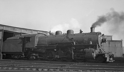 2021.003.TPW.0043B--john s ingles 116 neg--TP&W--steam locomotive 2-8-2 43 at roundhouse--East Peoria IL--1948 0217