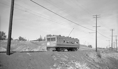 2021.003.DIM.0818--john s ingles 116 neg [JO Riley]--D&IM--wooden interurban car 818 west of at Barnum Jct approaching Know Ct crossing on Route 84 to Denver--Denver CO--1950 0601