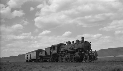 2021.003.UP.0535B--john s ingles 116 neg--UP--steam locomotive 2-8-0 535 with baggage car on fantrip--location unknown--no date