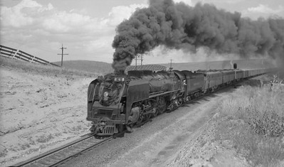 2021.003.UP.0818A--john s ingles 116 neg--UP--steam locomotive 4-8-4 818 doublehead with EMD diesel on passenger train 9 action--location unknown--no date