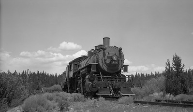 2021.003.UP.0535A--john s ingles 116 neg--UP--steam locomotive 2-8-0 535 with baggage car on fantrip--location unknown--no date
