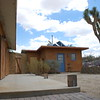Back patio, utility room and Joshua tree of John's home.