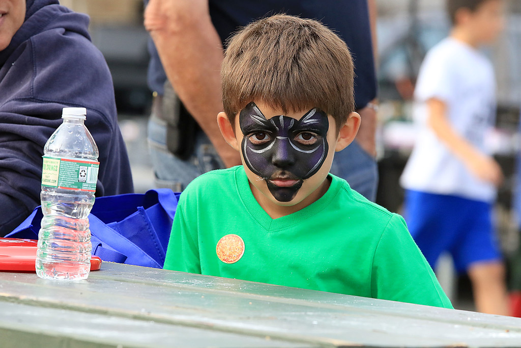 . The 25th anniversary of the Johnny Appleseed Festival was held on Saturday in downtown Leominster, September 22, 2018. Dominic Sanchez, 6, had his face painted like a cat during the festival. SENTINEL & ENTERPRISE/JOHN LOVE