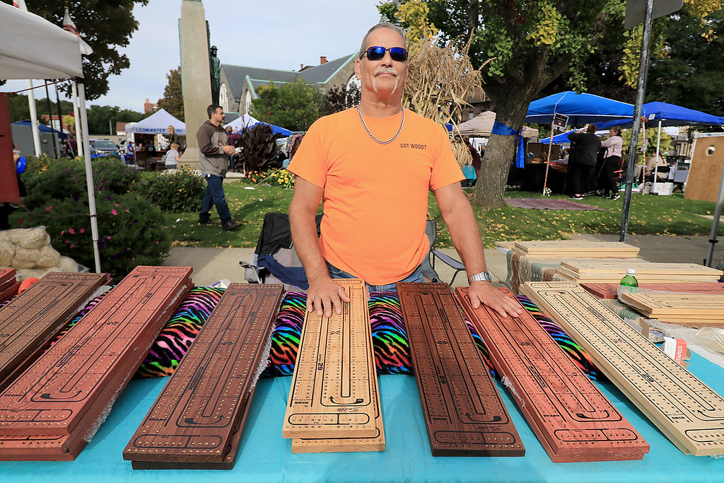 . The 25th anniversary of the Johnny Appleseed Festival was held on Saturday in downtown Leominster, September 22, 2018. Bruce Roberts from Fitchburg shows off the cribbage boards he makes that where for sale at the festival. SENTINEL & ENTERPRISE/JOHN LOVE