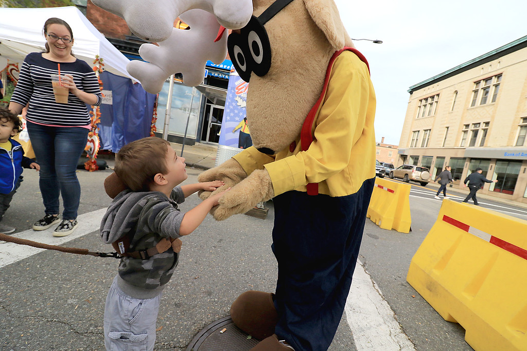 . The 25th anniversary of the Johnny Appleseed Festival was held on Saturday in downtown Leominster, September 22, 2018. Jasper Mazzaferro, 2, mets the Leominster Elks mascot during the festival. SENTINEL & ENTERPRISE/JOHN LOVE