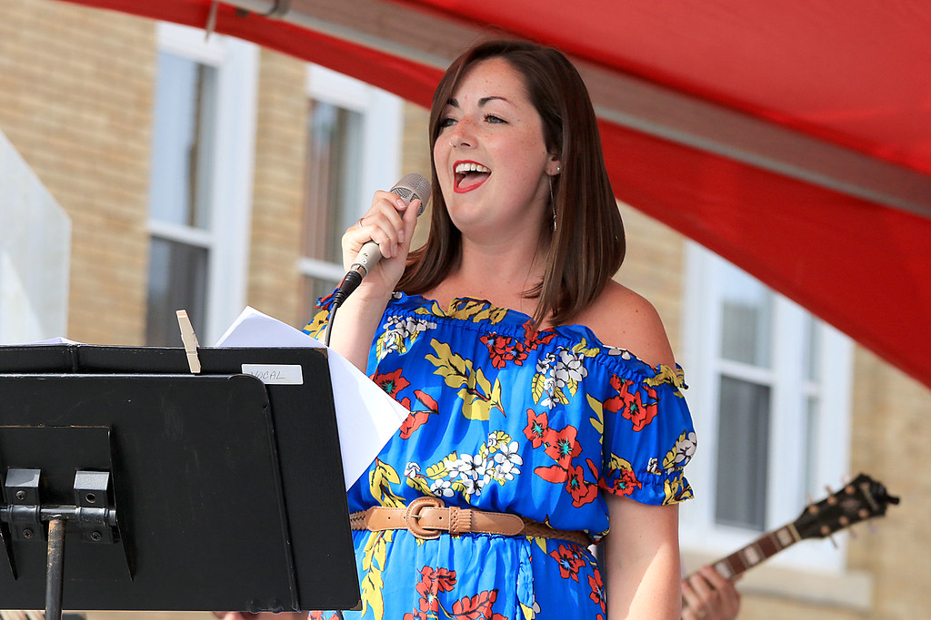 . The 25th anniversary of the Johnny Appleseed Festival was held on Saturday in downtown Leominster, September 22, 2018. Taylor Landry sings with the Johnny Appleseed Big Band at the festival. SENTINEL & ENTERPRISE/JOHN LOVE