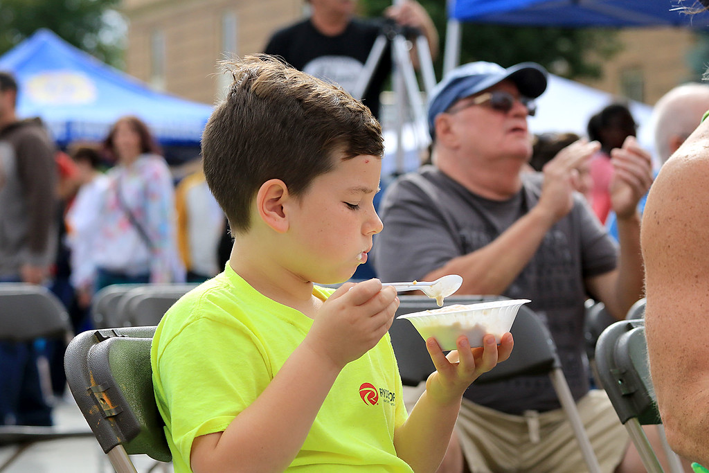 . The 25th anniversary of the Johnny Appleseed Festival was held on Saturday in downtown Leominster, September 22, 2018. Jack DeCesare, 7, from Lunenburg eats some apple crisp at the festival as he listens to the Johnny Appleseed Big Band. SENTINEL & ENTERPRISE/JOHN LOVE