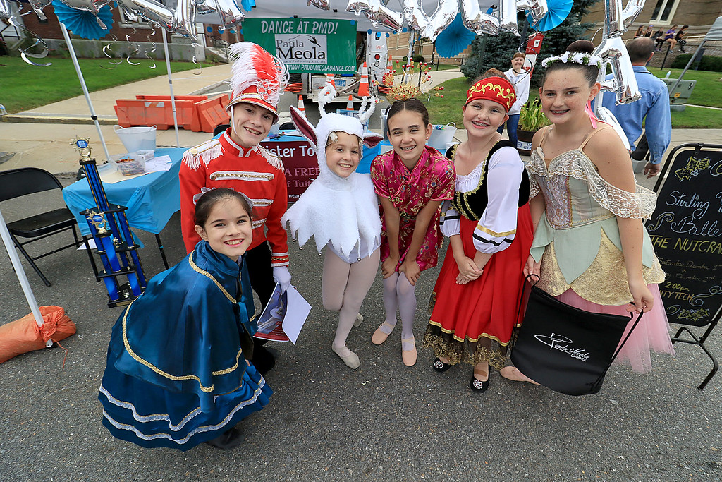 . The 25th anniversary of the Johnny Appleseed Festival was held on Saturday in downtown Leominster, September 22, 2018. Dancers with Paula Meola Dance Studio out of Shirley pose at their booth during the festival. From left is Rosebelle Cormier, 10, Darien Cormier, 12, Mia Lellios, 11, Mia Clements, 11, Madisyn Packard, 11, and Karina McCormack, 12. SENTINEL & ENTERPRISE/JOHN LOVE