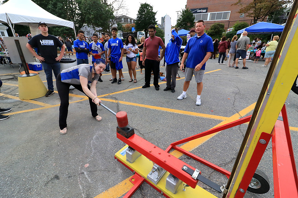 . The 25th anniversary of the Johnny Appleseed Festival was held on Saturday in downtown Leominster, September 22, 2018. Destina Vivoamore, 16, of Leominster, the girls volleyball team captain, swings the mallet to try and ring the bell of a strong man game at the festival. SENTINEL & ENTERPRISE/JOHN LOVE