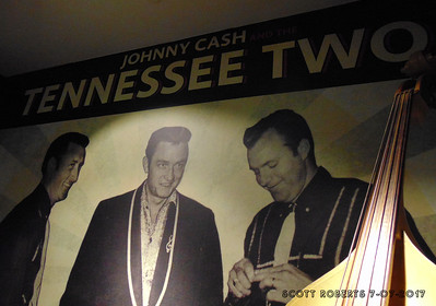 "The Tennessee Three was formed after Cash returned from Germany in 1954 where he served in the US Air Force. The band consisted of Johnny Cash, Marshall Grant and Luther Perkins. When they went in to record their first album for Sun Records, the label's owner,  Sam Phillips, suggested the band change their name to Johnny Cash and the Tennessee Two instead of the Tennessee Three. In 1955, the band recorded ""Folsom Prison Blues"" and the legend was born."