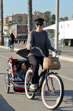 Laeticia Rides Her Bicycle.