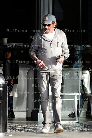 Johnny HallydaySmoke a new cigarette after smoking Gitane with no filter for many years, in Pacific Palisades, California