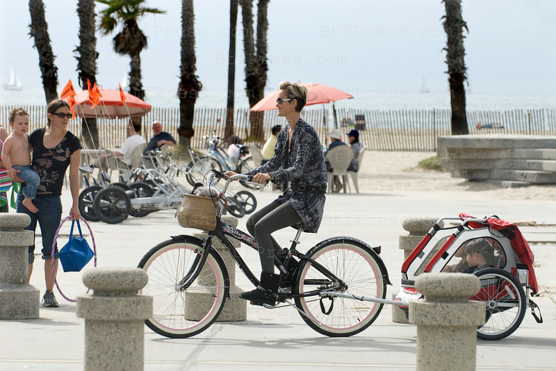Johnny Hallyday, Laeticia with Joy and Jade,Gilbert Coullier and his wife Nicole biking in Venice,California