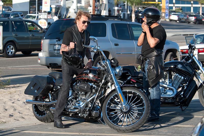 Johnny Hallyday looks happy on his bike