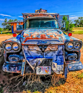 Route 66 in Tucumcari, NM. This colorful truck was actually very drab with a faded paint job. Messing around with the white balance and a little Topaz Adjust I was able to brighten it up.