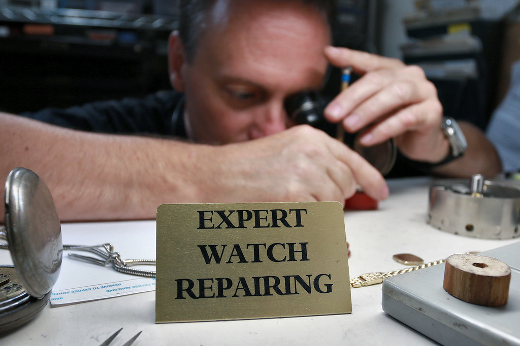 . This sign sits on John Lynch\'s desk in his shop John\'s Watch and Jewelry in Lunenburg. SENTINEL & ENTERPRISE/JOHN LOVE