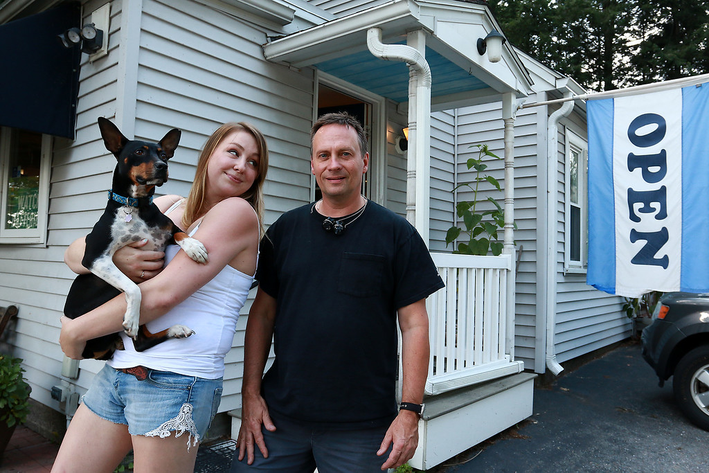 . John Lynch and his employee Katie Forster and her dog Cayb stand out in front of his shop John\'s Watch and Jewelry on Thursday, August 10, 2017. SENTINEL & ENTERPRISE/JOHN LOVE