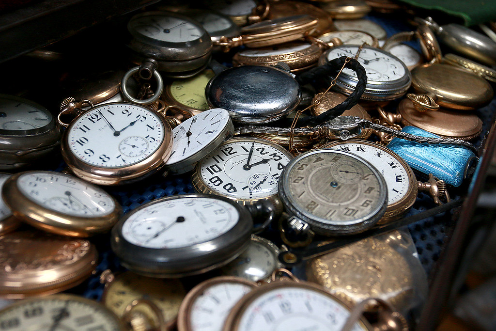 . John Lynch shows off a drawer full of pocket watches in his shop at John\'s Watch and Jewelry in Lunenburg. SENTINEL & ENTERPRISE/JOHN LOVE