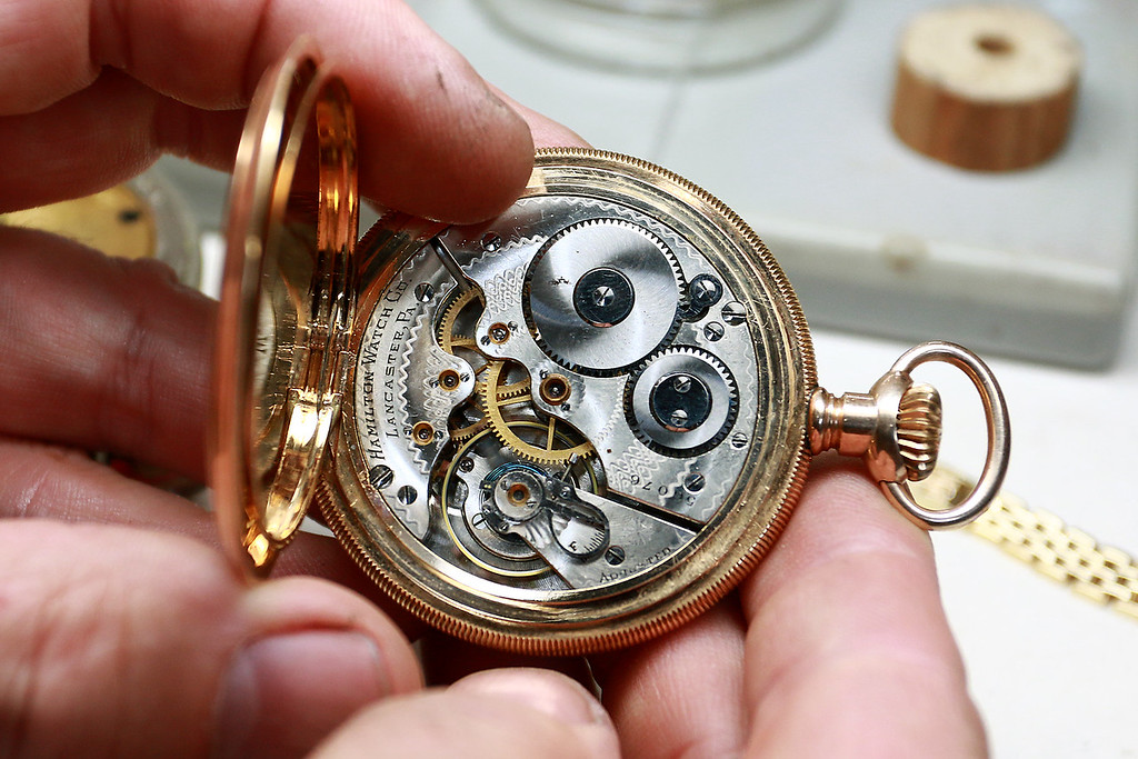 . John Lynch shows off the inner workings of a pocket watch he had at his shop John\'s Watch and Jewelry on Thursday, August 10, 2017. SENTINEL & ENTERPRISE/JOHN LOVE