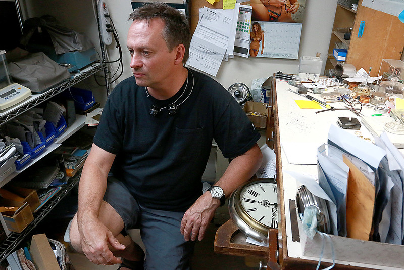 John Lynch spends a few minutes discussing the thousands of watches he's repaired at his Lunenburg business, John's Watch and Jewelry. SENTINEL & ENTERPRISE/JOHN LOVE