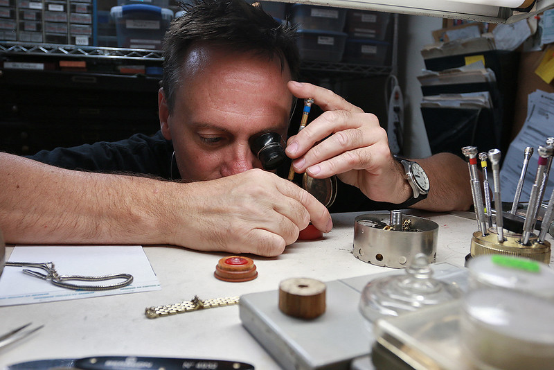 John Lynch shows how he fixes a pocket watch at his shop John's Watch and Jewelry on Thursday, August 10, 2017. SENTINEL & ENTERPRISE/JOHN LOVE