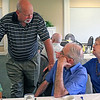 Roger Schneider | The Goshen News<br /> Darwin Hoogenboom, standing, chats Saturday with Charles Stauffer and Barb Grooms at the final meeting of the Johnson Controls retirees club.