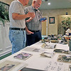 Roger Schneider | The Goshen News<br /> Jim Gunn, left, and Ben Blosser, look over items that were made at Johnson Controls in Goshen. Gunn's wife Irene worked at the plant and Blosser said he worked for 36 years at the plant.