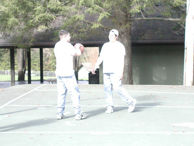 Michael and Kevin playing basketball.