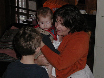 Portia holding Christian and speaking with Hayden.
