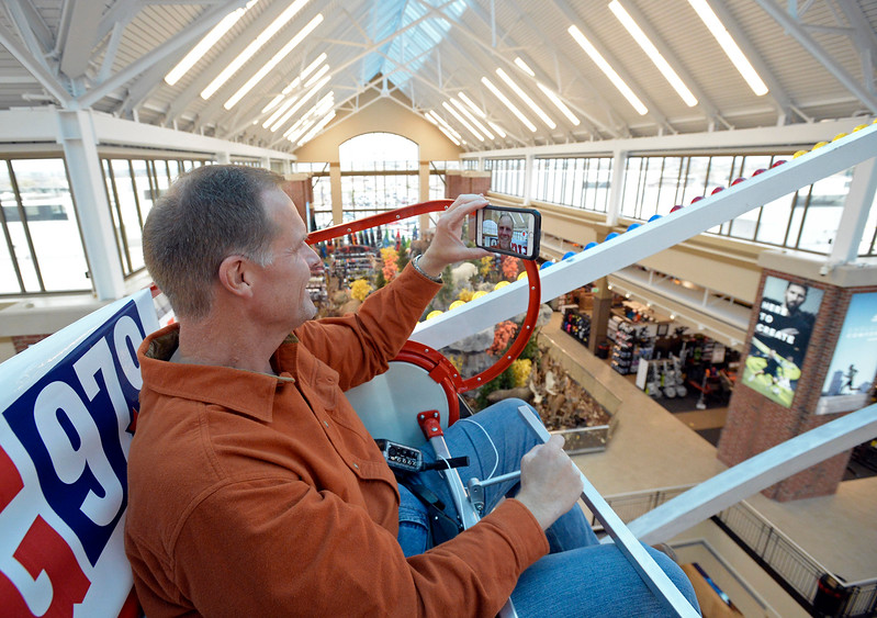 Scott James, Johnstown Mayor, takes a video of himself while riding the Scheels ferris wheel Thursday, Oct. 26, 2017, in Johnstown. Scott plans to ride the ferris wheel for 50 hours straight to raise money for the Larimer and Weld Food Banks. He will ride night and day with a five minute restroom break every hour and a 15 minute stretching break every four hours, Thursday to Saturday.  (Photo by Jenny Sparks/Loveland Reporter-Herald)