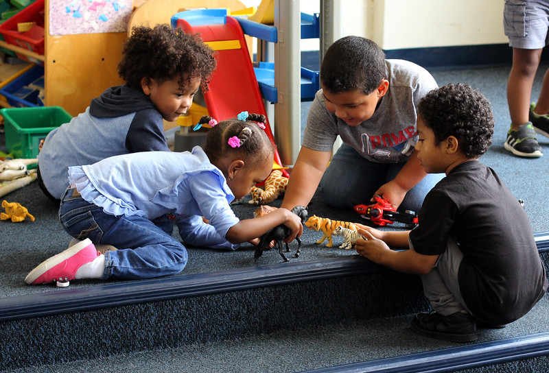 Lynn, Ma. 9-18-17. Zion Chyrack, London Phillips, Demani Guanci-Foster, and Brien Fowler playing at the Joi Child Care Center.