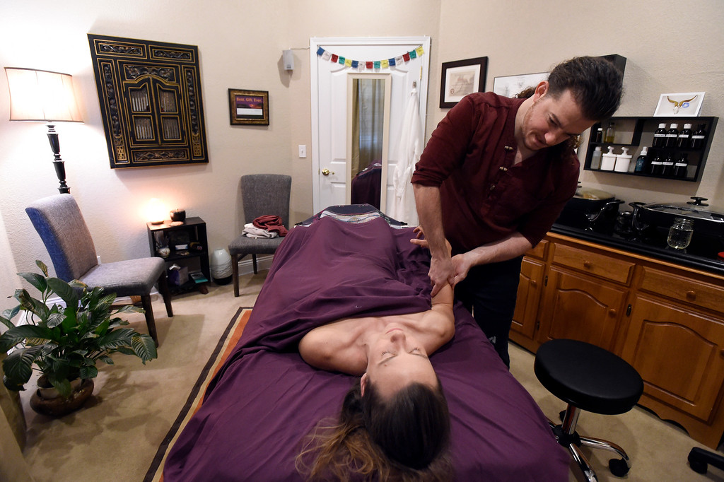 . LAFAYETTE, CO - NOVEMBER 19, 2018: Licensed Massage Therapist Jonathan Grassi gives a massage to Katie McDonald, of Westminster, on Monday at Inner Ocean Center for Healing in Lafayette. For more photos of Grassi at work go to dailycamera.com (Photo by Jeremy Papasso/Staff Photographer)