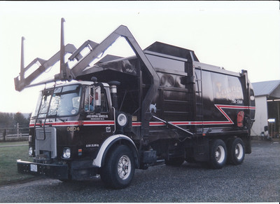White GMC Wittke Front Loader