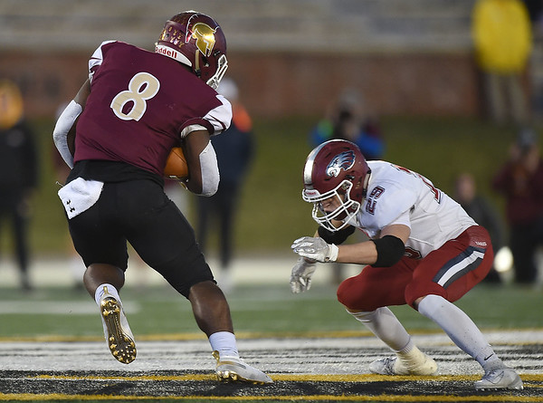Joplin's Eli Eminger (29) prepares to bring down DeSmet's Taj Butts (8) during their Class 6 Championship game on Saturday in Columbia.<br /> Globe | Laurie Sisk