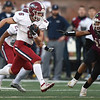 Joplin's Nathan Glades (6) runs for a long gain as DeSmet's Kaleb Purdy (25) gives chase during their Class 6 Championship game on Saturday in Columbia.<br /> Globe | Laurie Sisk