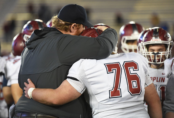 Joplin coach Curtis Jasper and senior Logan Myers embrace after thwir  Class 6 Championship game on Saturday in Columbia.<br /> Globe   Laurie Sisk