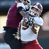 Joplin receiver Zach Westmoreland, right and DeSmet defensive back Jordan Johnson battlw for a pass during their Class 6 Championship game on Saturday in Columbia.. Westmoreland was able to win the battle for a long gain.<br /> Globe | Laurie Sisk