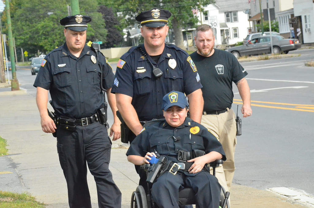 . John Brewer - Oneida Daily Dispatch Make-A-Wish recipient Jordan Barahmeh attends his first day on the job as an honorary Oneida City Police officer on Tuesday, Aug. 29, 2017.