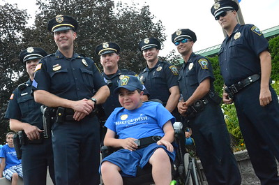 John Brewer - Oneida Daily Dispatch Make-A-Wish recipient Jordan Barahmeh is informed his wish of becoming an Oneida police officer is coming true during the New York State Fair in Geddes on Monday, Aug. 28, 2017.