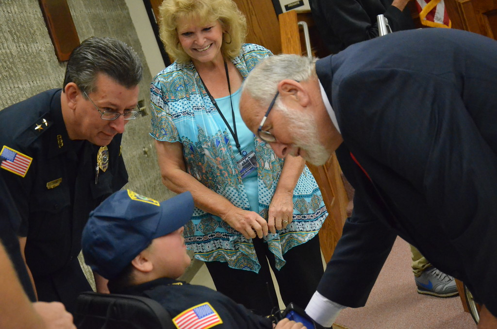 . John Brewer - Oneida Daily Dispatch Make-A-Wish recipient Jordan Barahmeh shakes hands with Oneida City Mayor Leo Matzke after being sworn in as an honorary Oneida City Police officer on Tuesday, Aug. 29, 2017.