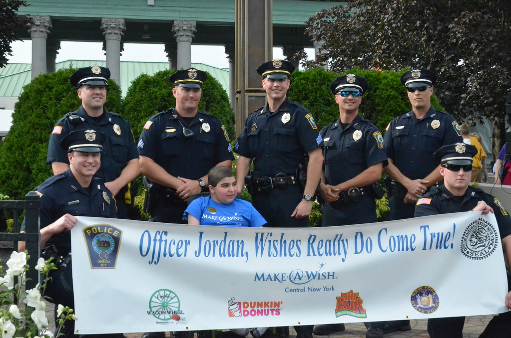 . John Brewer - Oneida Daily Dispatch Make-A-Wish recipient Jordan Barahmeh is informed his wish of becoming an Oneida police officer is coming true during the New York State Fair in Geddes on Monday, Aug. 28, 2017.