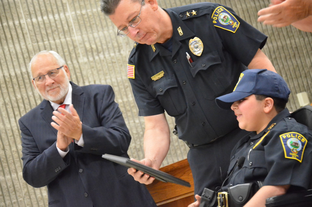 . John Brewer - Oneida Daily Dispatch Make-A-Wish recipient Jordan Barahmeh is congratulated by Oneida City Mayor Leo Matzke, left, and Oneida City Police Chief Paul Thompson after being sworn in as an honorary Oneida City Police officer on Tuesday, Aug. 29, 2017.