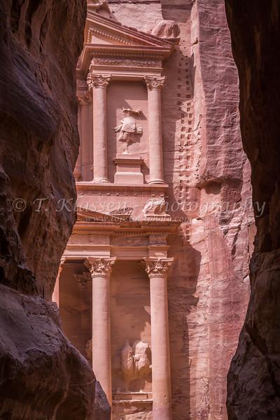 The Treasury building, Al Khazneh visable through an opening in the siq in Petra, Hashemite Kingdom of Jordan.
