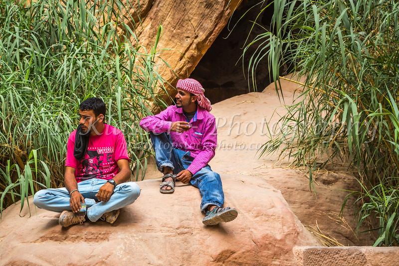Jordanian guides in the narrow siq entrance to Petra, Hashemite Kingdom of Jordan.