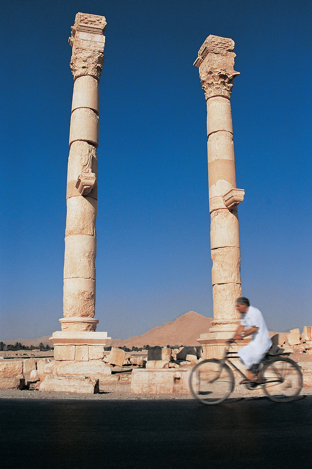 Cyclist and Ruins of Palmyra, Syria